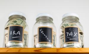 Three Glass Jars On Wooden Shelf For Savings